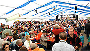 In full swing, the crowd in Maierhöfen sits down for an afternoon of eating, drinking and music after the cattle have been dispersed.