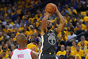 April 30, 2019; Oakland, CA, USA; Golden State Warriors guard Andre Iguodala (9) shoots the basketball against Houston Rockets guard Chris Paul (3) during the third quarter in game two of the second round of the 2019 NBA Playoffs at Oracle Arena. The Warriors defeated the Rockets 115-109.