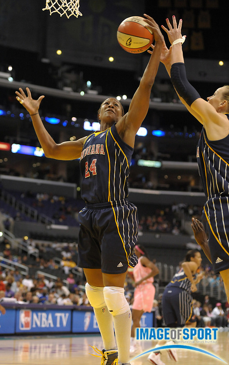 Aug 9, 2010; Los Angeles, CA, USA;  Indiana Fever forward Tamika Catchings (24) rebounds the ball during the game against the Los Angeles Sparks at the Staples Center. The Fever defeated the Sparks 82-76. Photo by Image of Sport