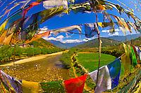 Foot bridge with prayer flags over the Paro River, Paro Valley, Bhutan