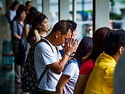 09 NOVEMBER 2017 - BANGKOK, THAILAND: A man bows his head as he walks in the skyway above Erawan Shrine on the 61st anniversary of the shrine's dedication. The Erawan Shrine is one of the most popular shrines in Bangkok. It was dedicated on November 9, 1956, after a series of construction accidents at what was then the Erawan Hotel (since torn down and replaced by the Grand Hyatt Erawan Hotel). The statue in the shrine is Phra Phrom, the Thai representation of the Hindu god of creation Brahma. It is a Hindu shrine popular with Thai and Chinese Buddhists because it is thought that making an offering to the Phra Phrom will bring good fortune.    PHOTO BY JACK KURTZ