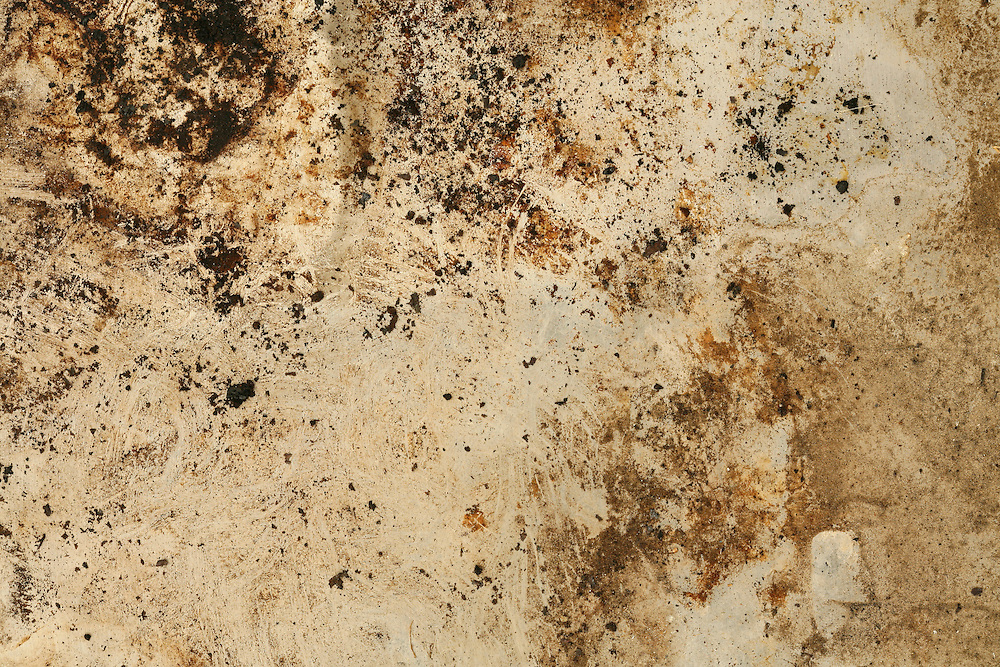 A natural texture from ashes and burn marks on brushed aluminum.