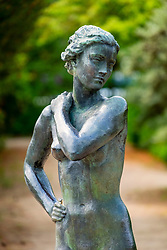 Female statue in Berlin Botanical Garden in Dahlem, Berlin, Germany
