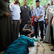 August 09, 2012 - Marea, Aleppo, Syria: A child cries the death of his 28 year old father, Housin Al Ali, a Free Syria Army fighter killed in combat in Alepo's Salehedine neighborhood...The Syrian army and the FSA have in the past week exchanged heavy fire in a battle for the control of Syria's economic capital, Aleppo. (Paulo Nunes dos Santos/Polaris)