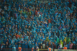 TRABZON, TURKEY - Thursday, August 26, 2010: Trabzonspor's supporters waring blue rain macs during the UEFA Europa League Play-Off 2nd Leg match against Liverpool at the Huseyin Avni Aker Stadium. (Pic by: David Rawcliffe/Propaganda)