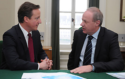 Leader of the Conservative Party David Cameron with Damian Green.Member of Parliament for Ashford in his office in Norman Shaw South, January 18, 2010. Photo By Andrew Parsons / i-Images.
