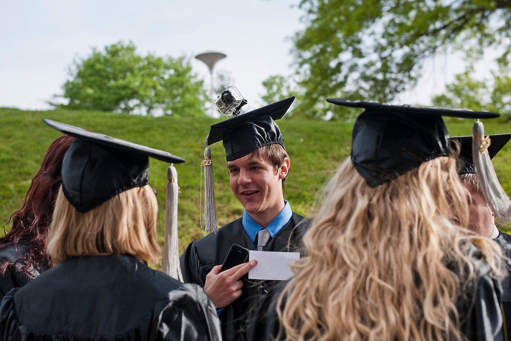 Ryan Murphy, a graduate of the School of Visual Communication, talks to some of his fellow graduates as he sports a GoPro video camera on the top of his cap during the morning commencement ceremony at the Convocation Center, Saturday, May 4, 2013. Murphy documented the ceremony in a unique way by hooking his camera to the top of his cap.