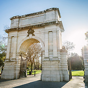 2012: Dublin, Ireland. Winter. The low winter sun shines behind the iconic arch at the enterance to Dublin's St. Stephen's Green Park