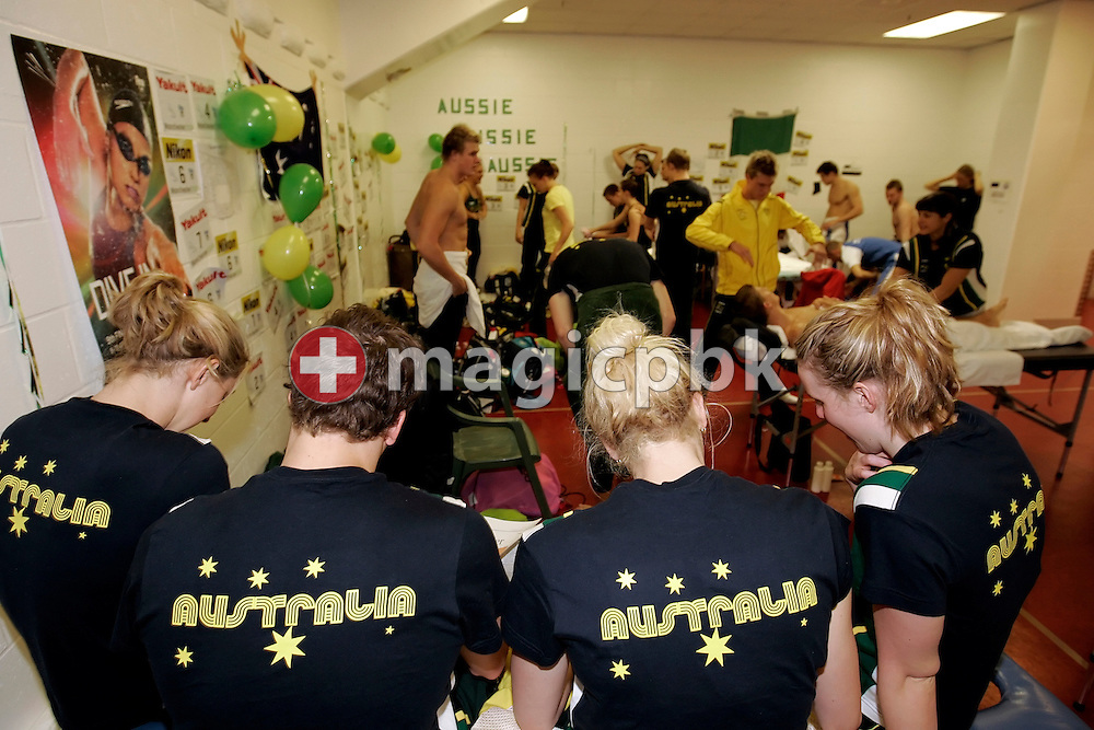 A look inside the Australian team preparation area before the start of the heats session in the Duncan Goodhew pool at the FINA Swimming World Championships (25m) in Manchester, Great Britain, Saturday, April 12, 2008. Australian swimmers (front) read the papers, while others prepare to compete. (Photo by Patrick B. Kraemer / MAGICPBK)