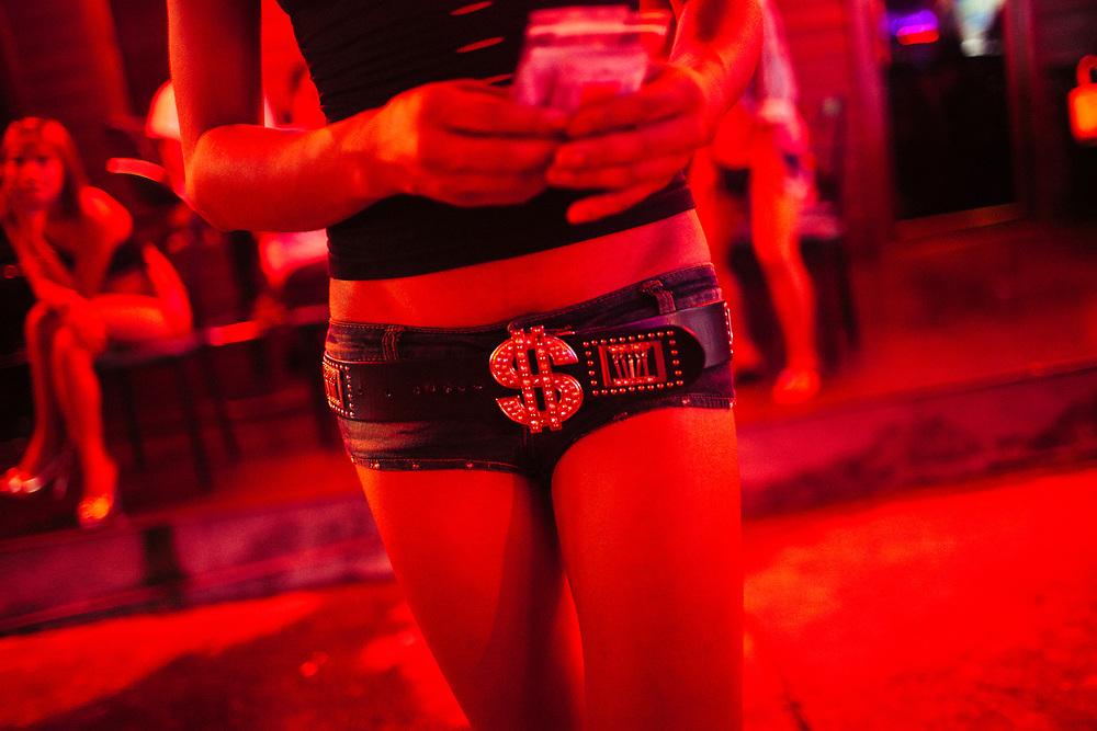 Ladyboy sex workers are given condoms most nights by non-profit groups promoting safe sex in Pattaya, Thailand.