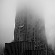 30 Rock disappears in the fog of Rockefeller Plaza