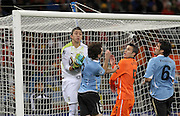 CAPE TOWN, SOUTH AFRICA- Tuesday 6 July 2010, Fernando Muslera grabs the ball during the semi final match between Uruguay and the Netherlands (Holland) held at the Cape Town Stadium in Green Point during the 2010 FIFA World Cup..Photo by Roger Sedres/Image SA