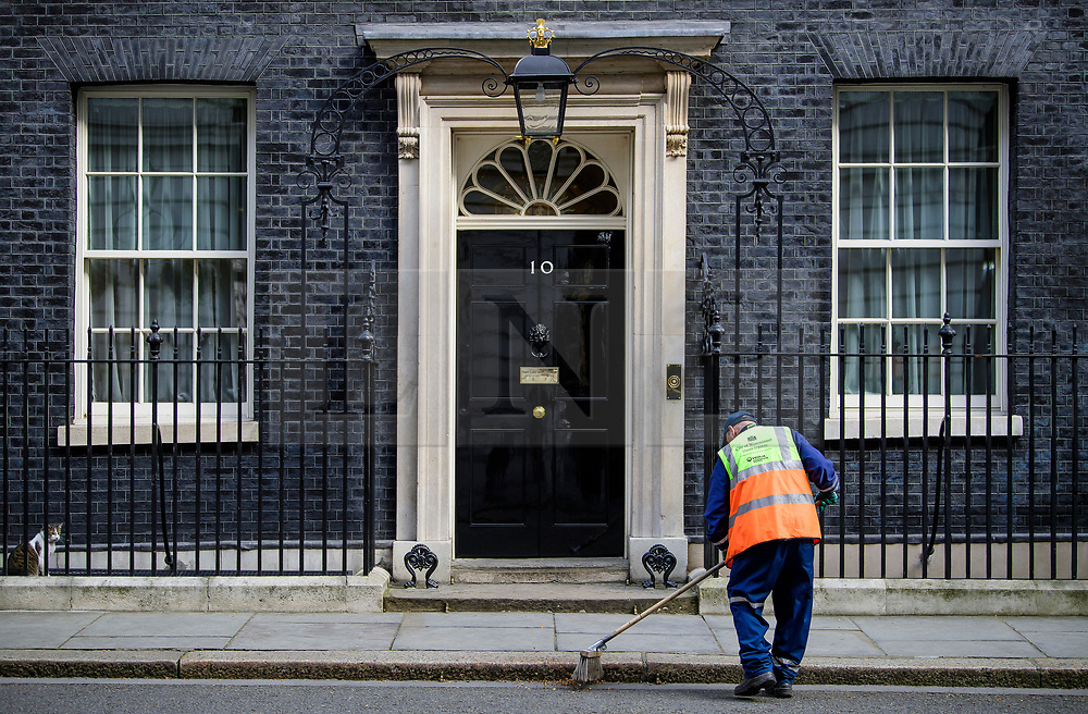 © Licensed to London News Pictures. 30/03/2017. London, UK. A Westminster Council street cleaner is seen sweeping the road in front of Number 10 Downing Street on March 30, 2017 Photo credit: Ben Cawthra/LNP