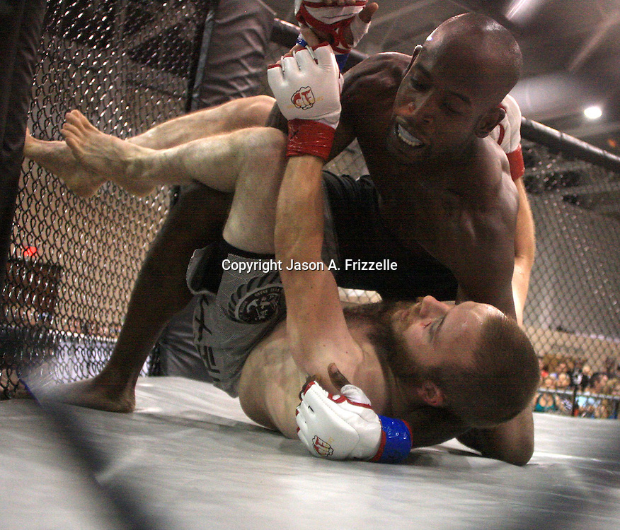 James Scibetti, bottom, fights Adrian Herd during Battle for a Fallen Soldier Saturday September 14, 2013 at the Wilmington Convention Center. The fights were part of a day that honored Sgt. T.J. Butler IV a local U.S. Army N.C. National Guardsman who was killed in Afghanistan. (Jason A. Frizzelle)