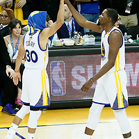 12 June 2017: Golden State Warriors guard Stephen Curry (30) celebrates with Golden State Warriors forward Kevin Durant (35) during the Golden State Warriors 129-120 victory over the Cleveland Cavaliers, in game 5 of the 2017 NBA Finals, at the Oracle Arena, Oakland, California, USA.