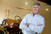 "9 July, 2008. Doylestow, PA. Jim Grundy, 54, is here next of the 1909 Pierce Arrow antique car he owns. He is the chief executor of Grundy Worldwide, an insurance company for collectible cars. His father Jim Sr. Jr.  started the business in 1947 and wrote the first antique car insurance policy in 1949. Jim Grundy has been in the business for 28 years and assumed major interest and the presidency 19 years ago. ""I own the best pre World War I cars ever manufactured"", Mr. Grundy says. <br /> <br /> ©2008 Gianni Cipriano for The Wall Street Journal<br /> cell. +1 646 465 2168 (USA)<br /> cell. +1 328 567 7923 (Italy)<br /> gianni@giannicipriano.com<br /> www.giannicipriano.com"