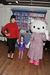 GIZZI ERSKINE and her niece EDIE FLYNN at a Hello Kitty Event at Liberty to lauch their collection of Hello Kitty products at Liberty, Great Marlborough Street, London on 25th September 2011.