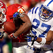 Kansas City Chiefs running back Priest Holmes, left, has the football punched out from his arm by Indianapolis Colts cornerback David Macklin, right, in the third quarter during the AFC Divisional Playoff Game at Arrowhead Stadium in Kansas City, Mo. The Colts recovered the fumble and went on to win 38-31, ending the Chiefs season.