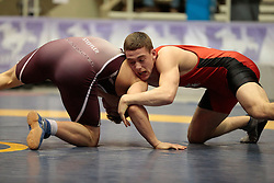 London, Ontario ---2013-03-02---   Grayson St. Lauirent of The University Of New Brunswick takes on Eric Steffler of Mcmaster in the men's 76 KG bronze medal match at the 2012 CIS Wrestling Championships in London, Ontario, March 02, 2013. .GEOFF ROBINS/Mundo Sport Images