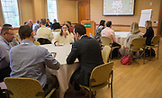 Attendees of the College of Business Center for Leadership Event talk amongst each other during a break in Baker Center on April 23, 2016.