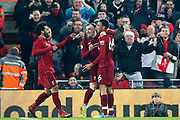 Liverpool midfielder Xherdan Shaqiri (23) Liverpool striker Mohamed Salah (11) and Liverpool defender Trent Alexander-Arnold (66) celebrate the third goal 3-0  during the Premier League match between Liverpool and Newcastle United at Anfield, Liverpool, England on 26 December 2018.
