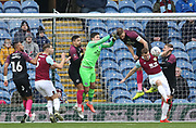 Chris Wood of Burnley and Christy Pym of Peterborough United in action during the The FA Cup match between Burnley and Peterborough United at Turf Moor, Burnley, England on 4 January 2020.