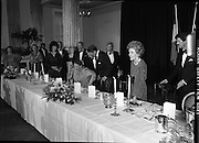 President Reagan Visits Ireland..(formal dinner)..1984.04.06.1984.06.04.1984.4th June 1984..The Banquet for President and Mrs Reagan was held in Dublin Castle,Dame St,Dublin..Photo of the top table as President Reagan assists Mrs Joan Fitzgerald to her seat.The Tanaiste, Mr Spring,assists the First Lady.