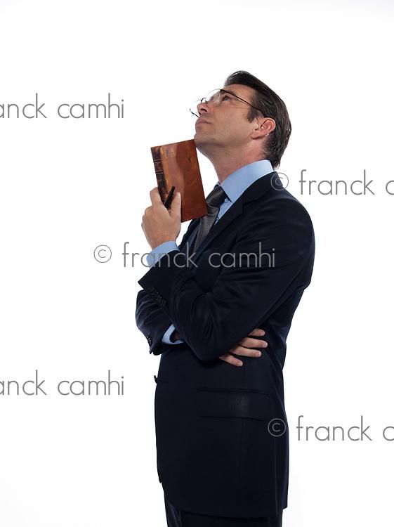 man caucasian teacher professor reading holding ancient book thinking isolated studio on white background