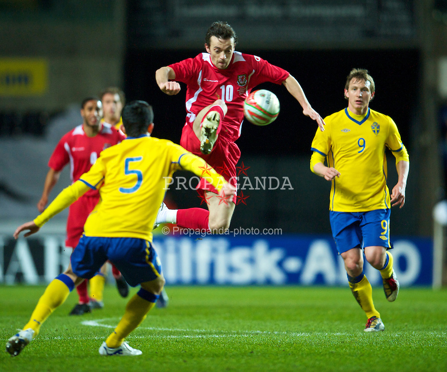 SWANSEA, WALES - Wednesday, March 3, 2010: Wales' Simon Davies in action against Sweden during the international friendly match at the Liberty Stadium. (Photo by David Rawcliffe/Propaganda)