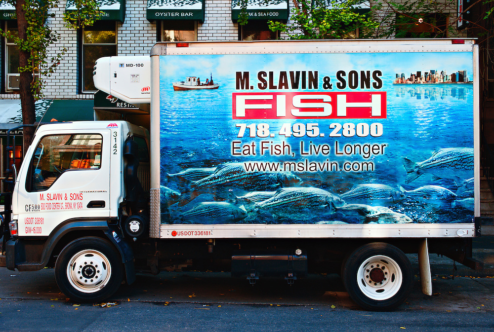 """Eat Fish, Live Longer"" sign on fish delivery truck, Hells Kitchen, New York, New York, US"
