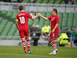 DUBLIN, REPUBLIC OF IRELAND - Friday, May 27, 2011: Wales' captain Aaron Ramsey celebrates scoring the first goal against Northern Ireland during the Carling Nations Cup match at the Aviva Stadium (Lansdowne Road). (Photo by David Rawcliffe/Propaganda)