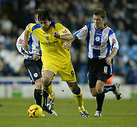 Photo: Aidan Ellis.<br /> Sheffield Wednesday v Cardiff City. Coca Cola Championship. <br /> 09/11/2005. Cardiff's Alan Lee gets awy from Sheffield's Burton O' Brien