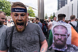 © Licensed to London News Pictures. 14/07/2017. London, UK. Boxing CONOR MCGREGOR fans queue up outside the Wembley SSE venue as professional boxer FLOYD MAYWEATHER and UFC Lightweight Champion CONOR MCGREGOR take part in final leg of their World Tour in London. The fight between the boxer and the UFC Lightweight Champion will take place on August in Las Vegas. Photo credit: Ray Tang/LNP