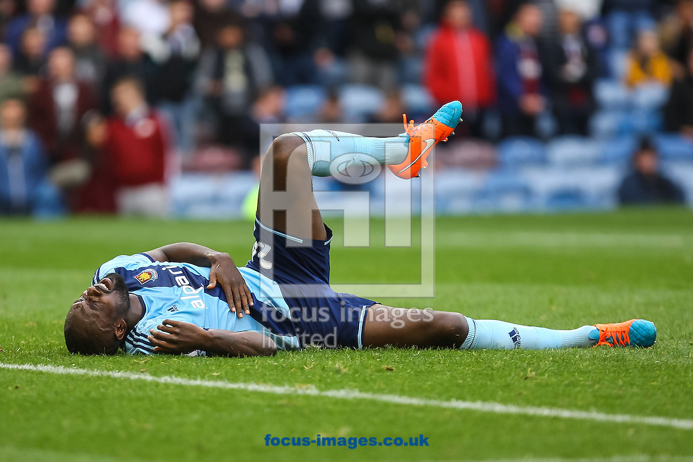 Carlton Cole of West Ham United lays injured during the Barclays Premier League match at Turf Moor, Burnley<br /> Picture by Daniel Chesterton/Focus Images Ltd +44 7966 018899<br /> 18/10/2014