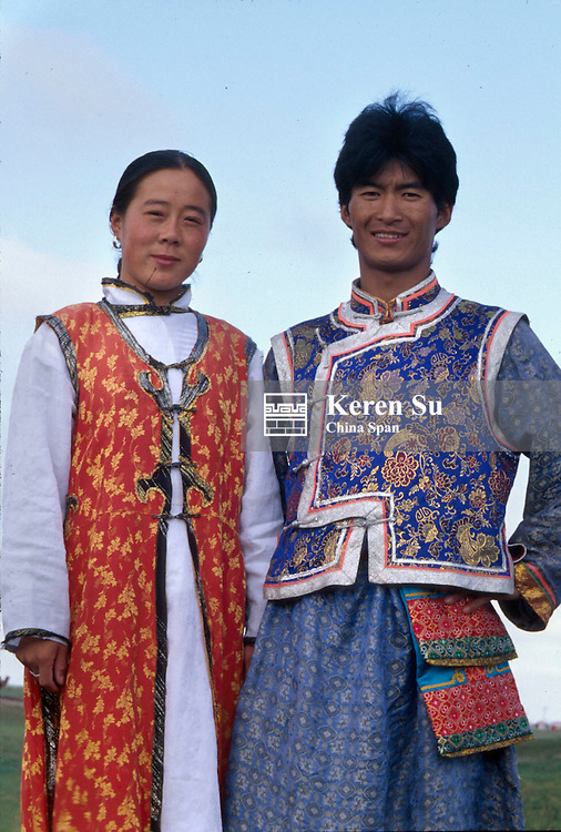 Mongolian young couple in traditional costume, Hohhot, Inner Mongolia, China