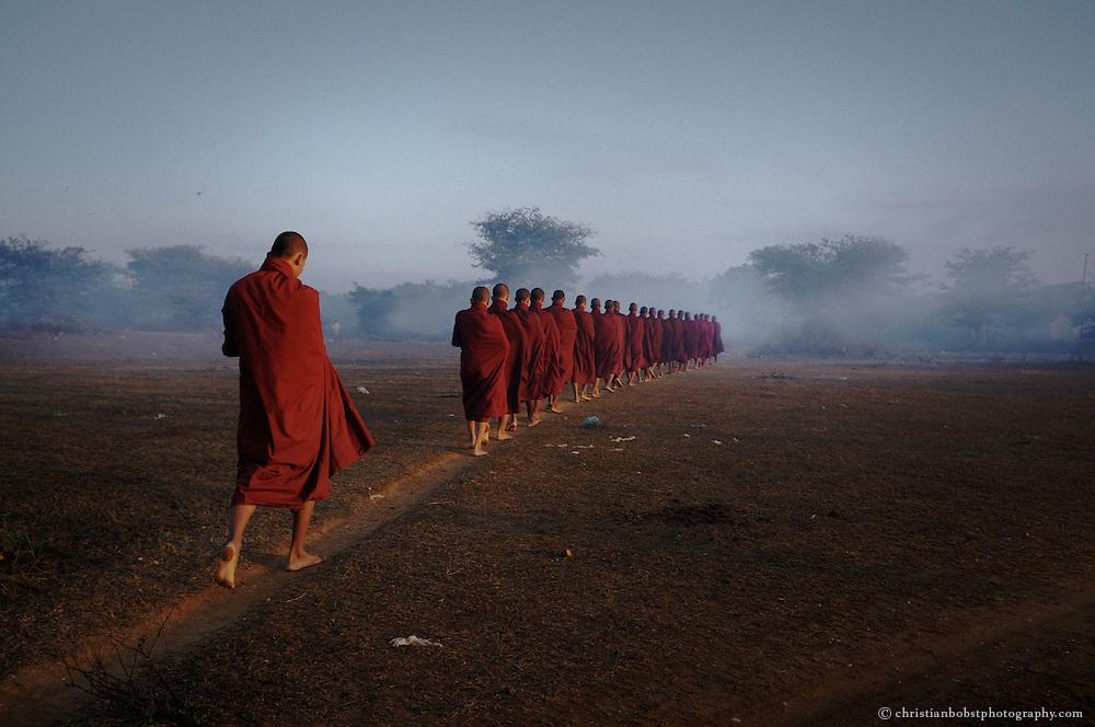 Burmese monks in the ealrly moring in Bagan, Myanmar.