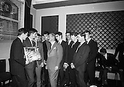 21/05/1966<br /> 05/21/1966<br /> 21 May 1966<br /> Castrol (Ireland) Ltd. presentation of Castrol Trophy to Home Farm football team at the Central Hotel, Dublin. Replicas were presented to each of the players and Drumcondra, who were runners-up received medals. Picture shows (l-r): Mr. Leonard A. Courtney, Managing Director of Castrol (Ireland) Ltd.  chatting with Jerry James, Captain of Home Farm and members of the team after the presentation. .