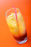 Studio shot of drink on orange background