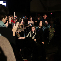 Participants dance during the I Am Beautiful fashion show to benefit the Miracle League of Wilmington. (Jason A. Frizzelle)