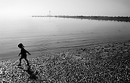 Young Girl Walking along Beach at low tide, East Coast - 1997