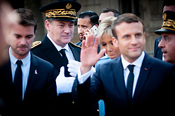 © Licensed to London News Pictures. FILE PICTURE 14/05/2017 Hôtel de Ville, Paris, France. Alexandre Benalla (centre rear) pictured with president Emmanuel Macron at his inauguration after being elected to office. Mr Benalla, a close security aide to Mr Macron, is facing disciplinary action after damning video evidence emerged of him assaulting demonstrators at a May Day demonstration while wearing a CRS riot helmet and a police armband - an ever present shadow to Mr Macron, Benalla continued to serve in his capacity as a security advisor and bodyguard following a light reprimand from the Elysee while the mounting scandal and accusations of an attempted cover up escalated. Macron called an emergency meeting on Sunday to manage the crisis, while Benalla was arrested and remanded in custody over the weekend on charges of violence by a public official, impersonating a police officer and the illegal use of police insignia. Benalla was due to be getting married on Saturday. Macron's popularity ratings fell to an all time low of 39% last week, quashing hopes that the World Cup win would give him a boost. Photo credit Guilhem Baker/LNP