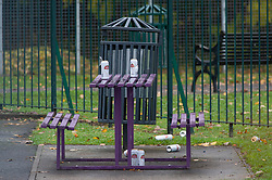 © Licensed to London News Pictures. 16/11/2018. Orpington, UK. Beer cans in Briset Park. A police cordon is in place with police standing guard after a 17 year old boy was stabbed multiple times in an attack last night in Eltham. Police were called at 10.25pm.The teenager remains critical but stable.Photo credit: Grant Falvey/LNP