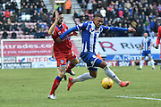 Wigan Athletic Defender, Reece Wabara on the ball during the Sky Bet League 1 match between Wigan Athletic and Oldham Athletic at the DW Stadium, Wigan, England on 13 February 2016. Photo by Mark Pollitt.
