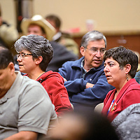 Community members react at the conclusion of a McKinley County Schools Board of Education meeting in Gallup Monday.  After more than two hours of Executive Session to discuss Limited Personnel Matters related to the investigation, contract and evaluation of Frank Chiapetti, the board recessed stating, no action would be taken at this time.