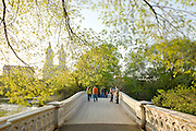 New York City.  Central Park in springtime on Bow Bridge with view of Central Park West Skyline and the San Remo apartment towers.