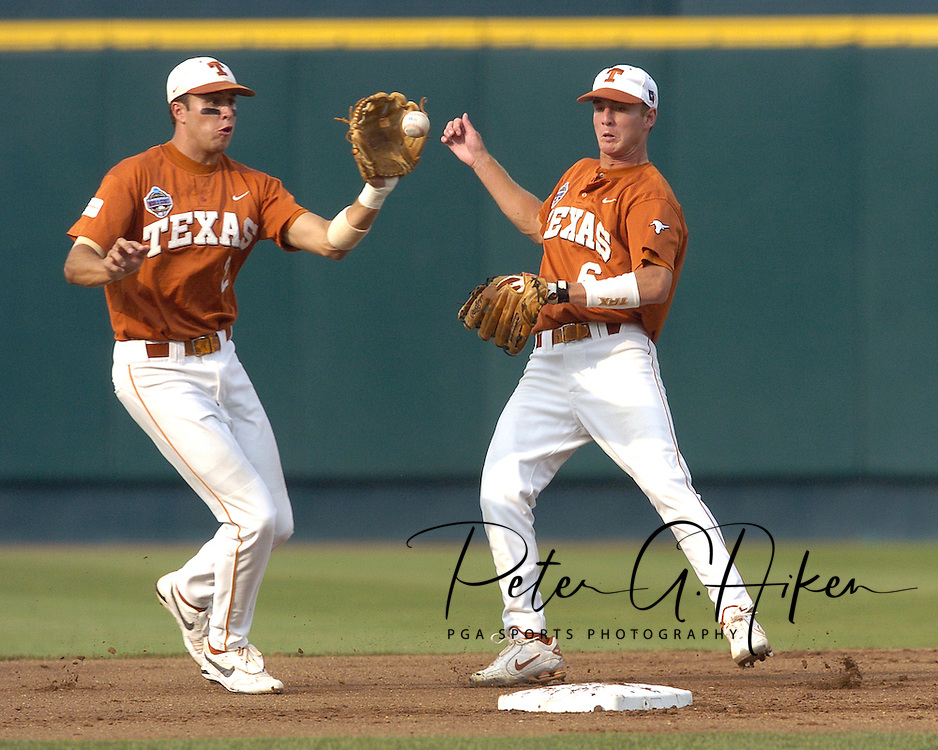 Texas shortstop basemen Seth Johnston (L) fields the ball in front of second basemen Robby Hudson (R) to start a double play in the bottom of the first inning.  defeated Florida 4-2 in game one of the Championship Series of the College World Series at Rosenblatt Stadium in Omaha, Nebraska on June 25, 2005.