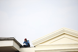 October 11, 2018 - Kathmandu, Nepal - A Nepalese Police man takes picture from a rooftop during a special function held to mark the Police day at Police Headquarters in Kathmandu, Nepal on Thursday, October 11, 2018. (Credit Image: © Skanda Gautam/ZUMA Wire)