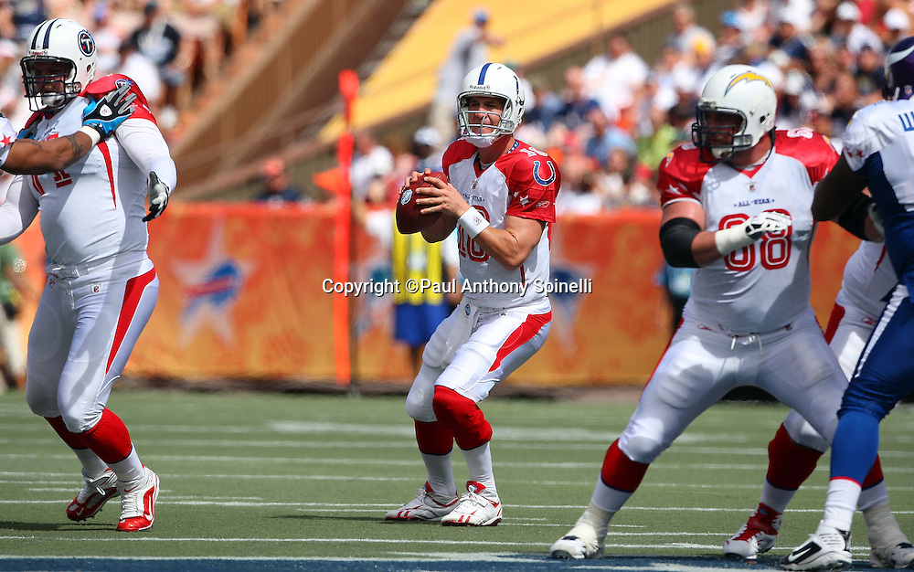 HONOLULU, HI - FEBRUARY 08: AFC All-Stars quarterback Peyton Manning #18 of the Indianapolis Colts drops back to pass against the NFC All-Stars in the 2009 NFL Pro Bowl at Aloha Stadium on February 8, 2009 in Honolulu, Hawaii. The NFC defeated the AFC 30-21. ©Paul Anthony Spinelli *** Local Caption *** Peyton Manning