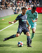LAFC forward Diego Rossi (9) gets past Seattle Sounders defender Kelvin Leerdam (18) during a MLS soccer match in Los Angeles, Sunday, April 21, 2019. LAFC defeated the Sounders 4-1. (Ed Ruvalcaba/Image of Sport)
