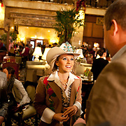 Sarah Wiens, Miss Rodeo Colorado, center, and Kelly Carlascio, Miss Rodeo North Dakota, talk with Randy Blach at the Brown Palace Hotel. The hotel hosts an afternoon tea event with the Grand Champion Steer from the stock show every year.